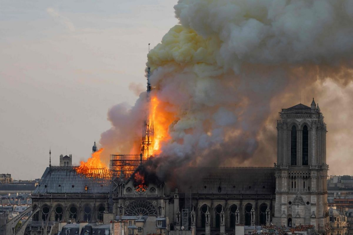 Smoke billows as flames burn through the roof of the Notre Dame Cathedral, on April 15, 2019.