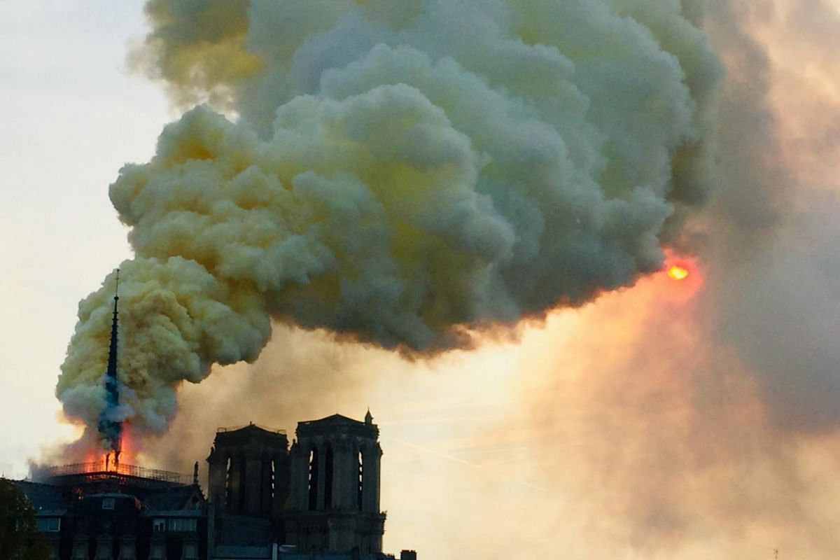 Flames and smoke are seen billowing from the roof at Notre Dame Cathedral in Paris, on April 15, 2019.