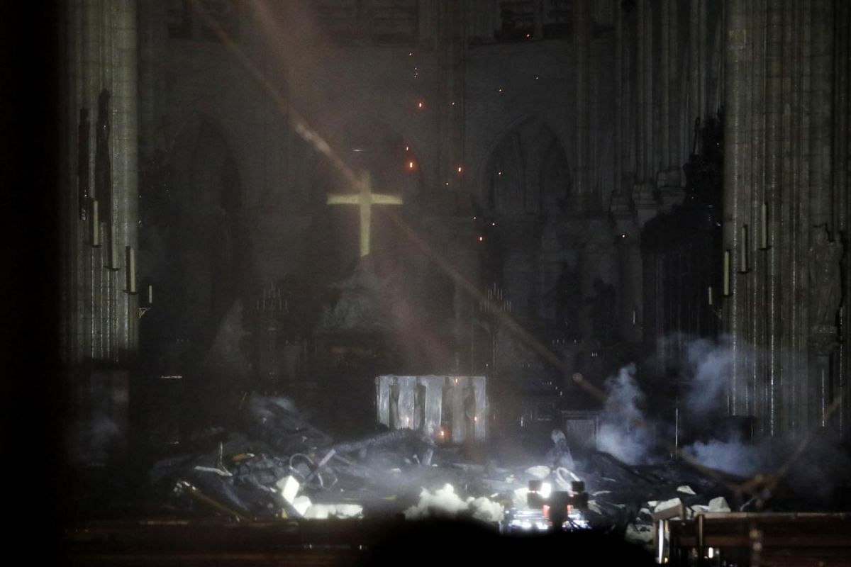 A general view of the interior of the Notre Dame Cathedral as flames burn the roof of the cathedral in Paris, on April 15, 2019.