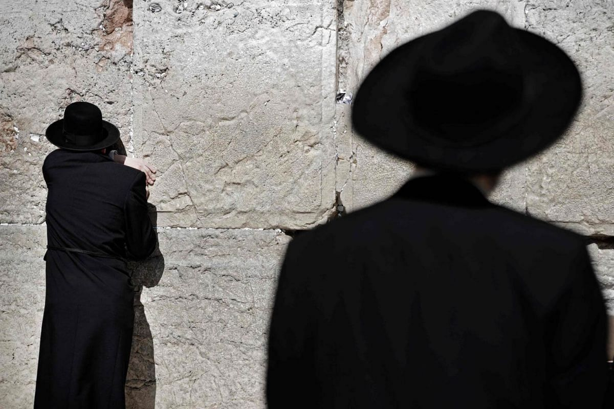 A worshipper at the Western wall, the holiest site where Jews can pray, in the Old City of Jerusalem, on April 16, 2019.