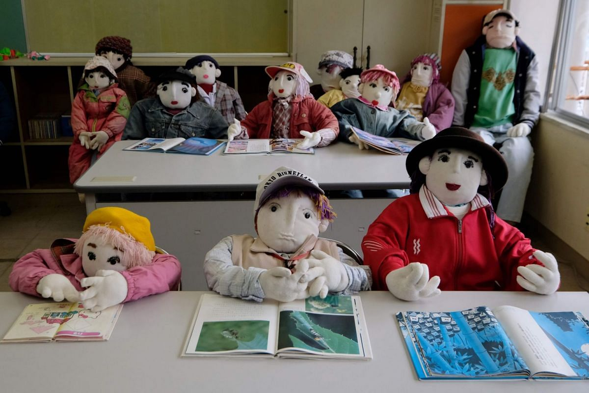 Life-sized dolls depicting schoolchildren at the elementary school that was closed seven years ago, as there was no one left to teach.