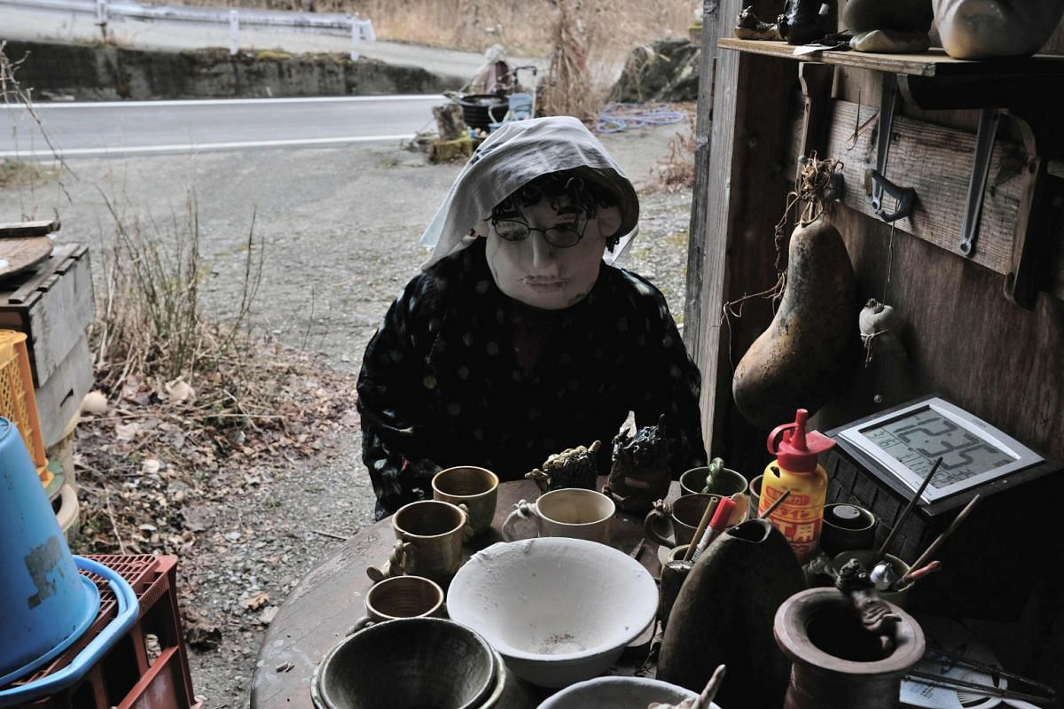 A life-sized doll on display at a house beside a road in Nagoro.