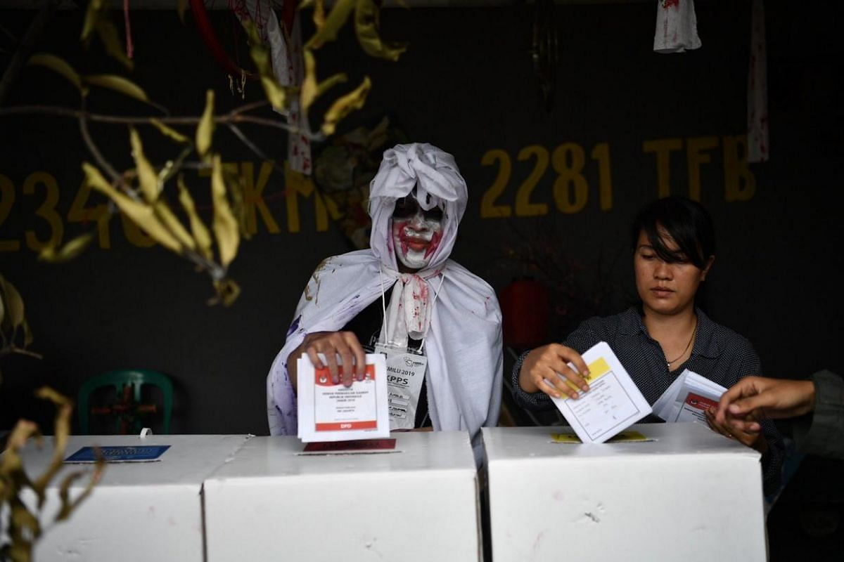 A horror-themed polling station in south Jakarta as Indonesian election officials come up with creative ways to draw crowds to the ballot box.