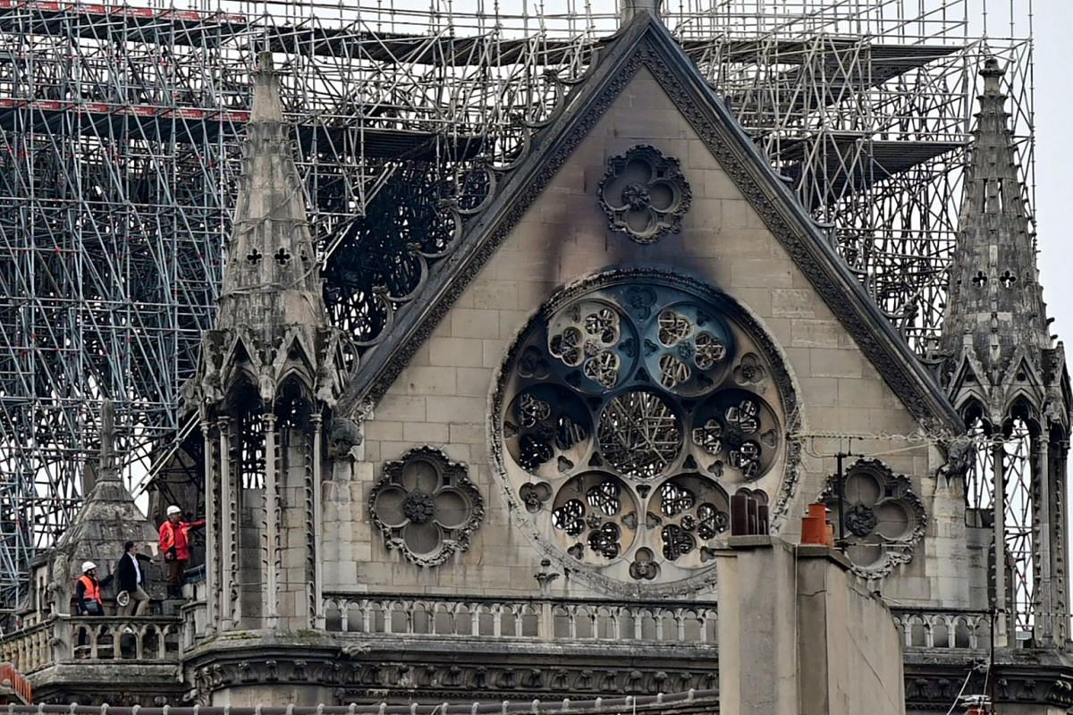 Inspectors are seen on the roof of the landmark Notre-Dame Cathedral in central Paris on April 16, 2019.