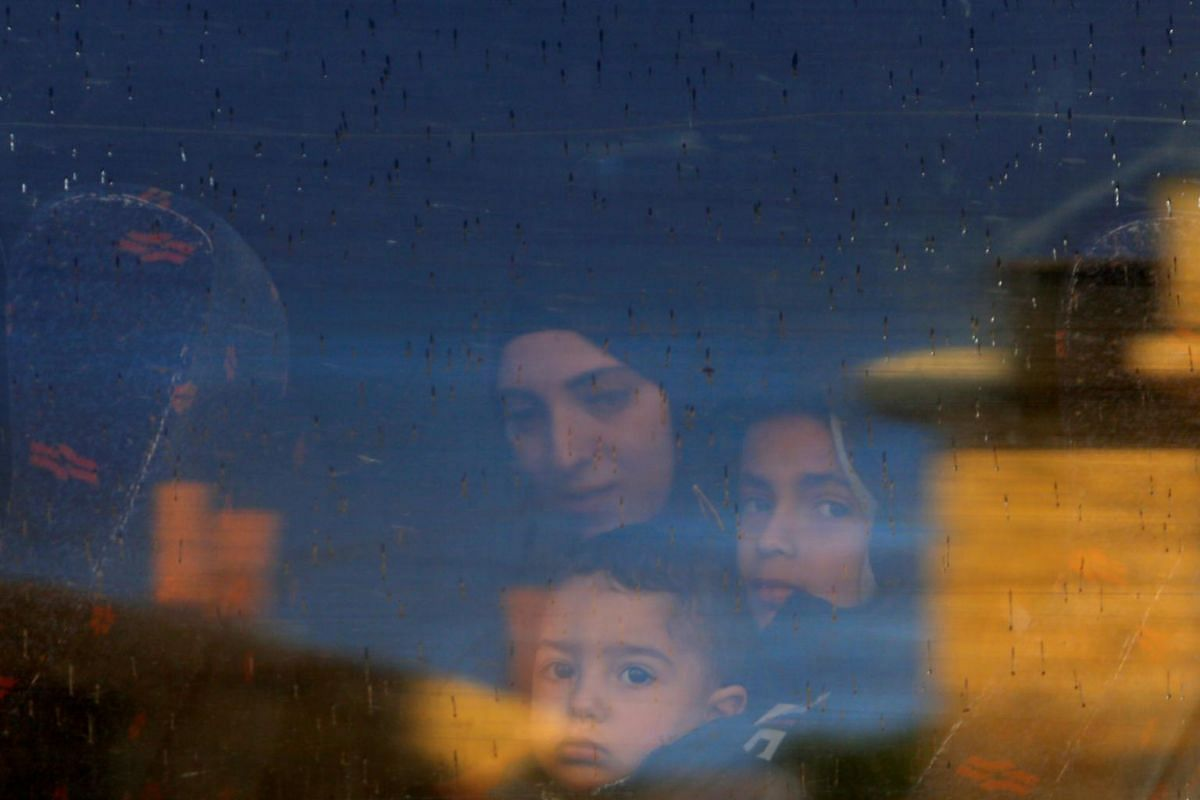 The wife and children of Palestinian prisoner Ayman Ghareeb, who is held in an Israeli jail, look out of a bus window on their way to visit him in the jail, as Palestinians mark Prisoners' Day, in Tubas in the Israeli-occupied West Bank on April 17,