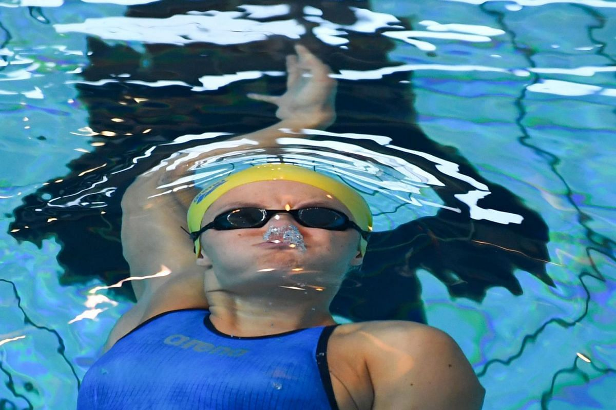 Pauline Mahieu competes in the women's 100m backstroke during the French swimming championships on April 17, 2019, in Rennes, western France.