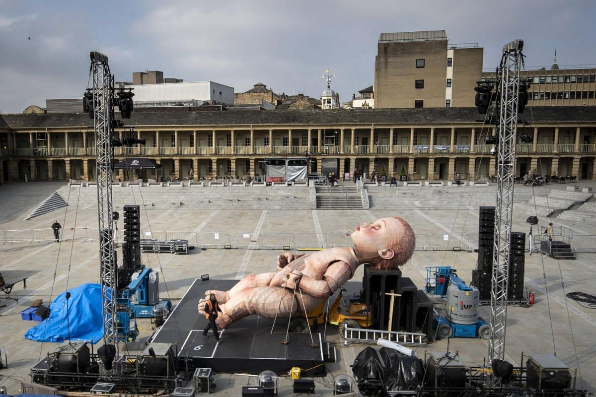 A giant mechanical baby is installed ahead of Mind the Gap Theatre Company's first performance of ZARA at the Halifax Piece Hall in Halifax, England on April 17, 2019.