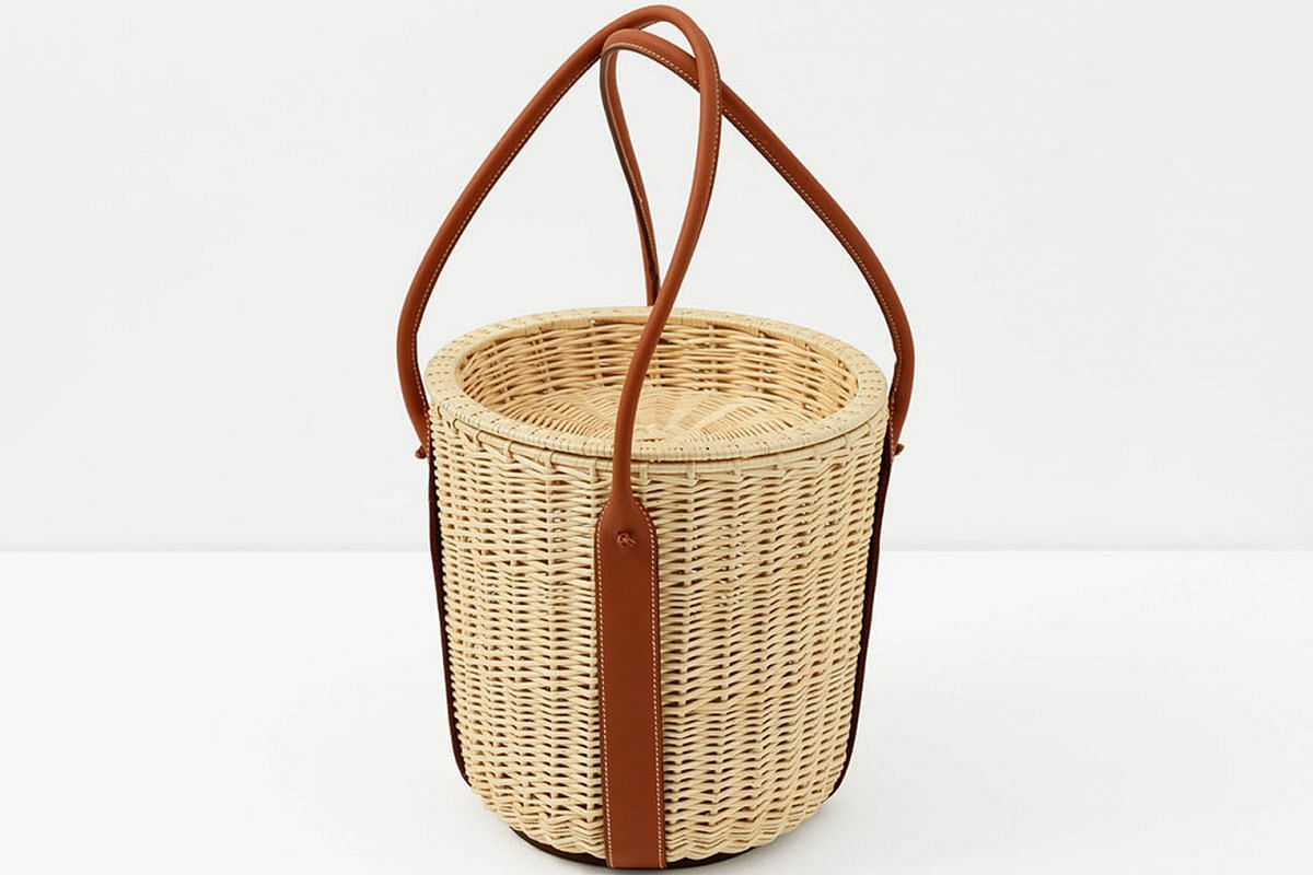 A Hermes wicker basket juxtaposes straw with fine leather.