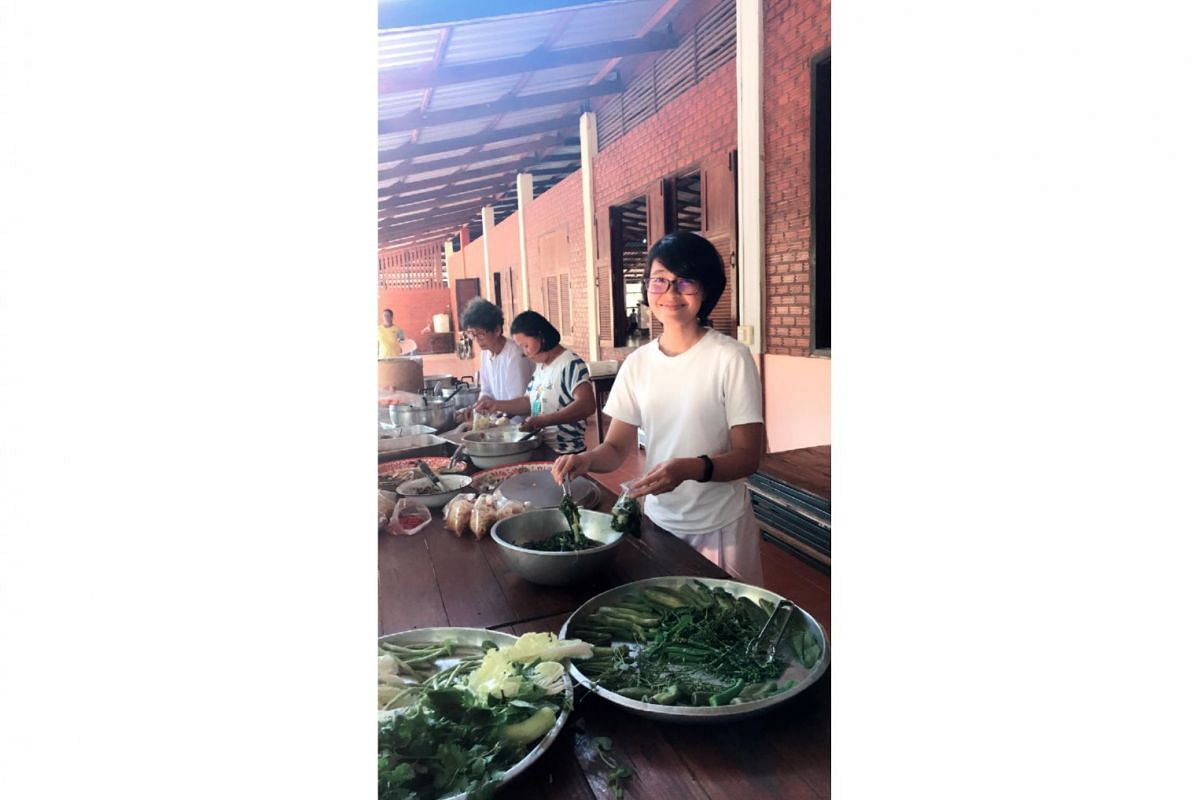 Entrepreneur Koh Kai Xin helping to pack leftover food for distribution in a monastery in Ubon Ratchathani, Thailand, this year. She enjoys going on Buddhist retreats, often for a month at a time.