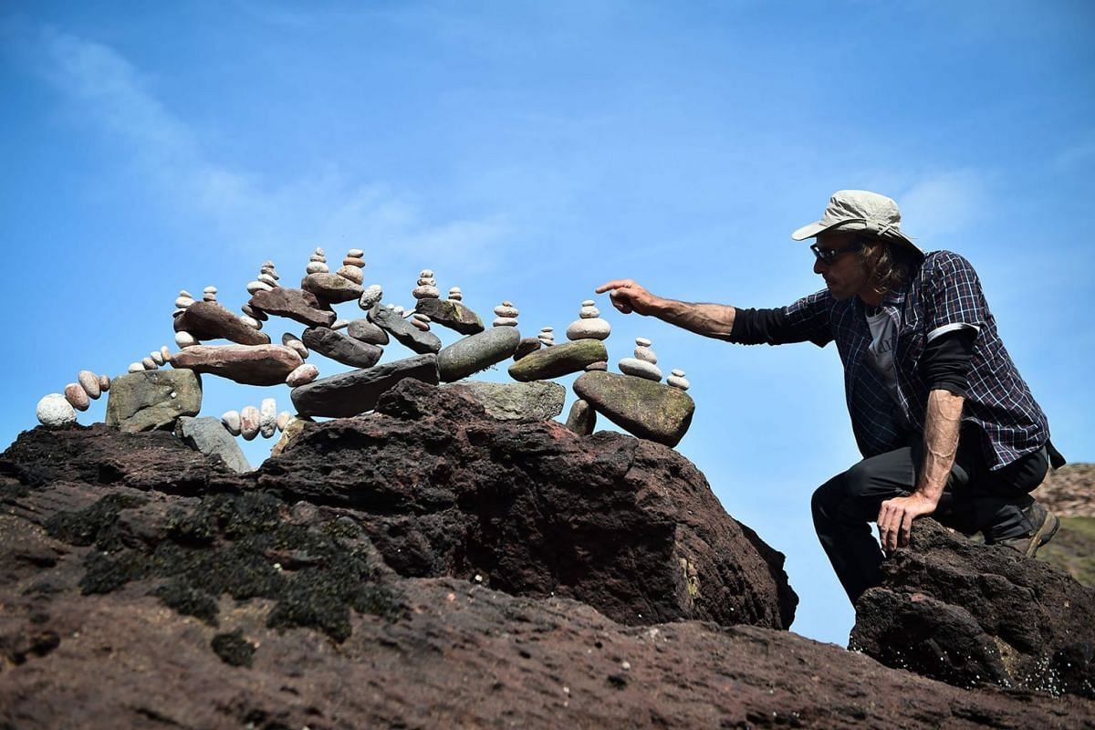 Pedro Duran from Spain competes in the European Stone Stacking Championships 2019 in Dunbar, Scotland, on April 21, 2019. Stackers compete in four competitions creating sculptures using stones and balancing them using only the force of gravity. PHOTO