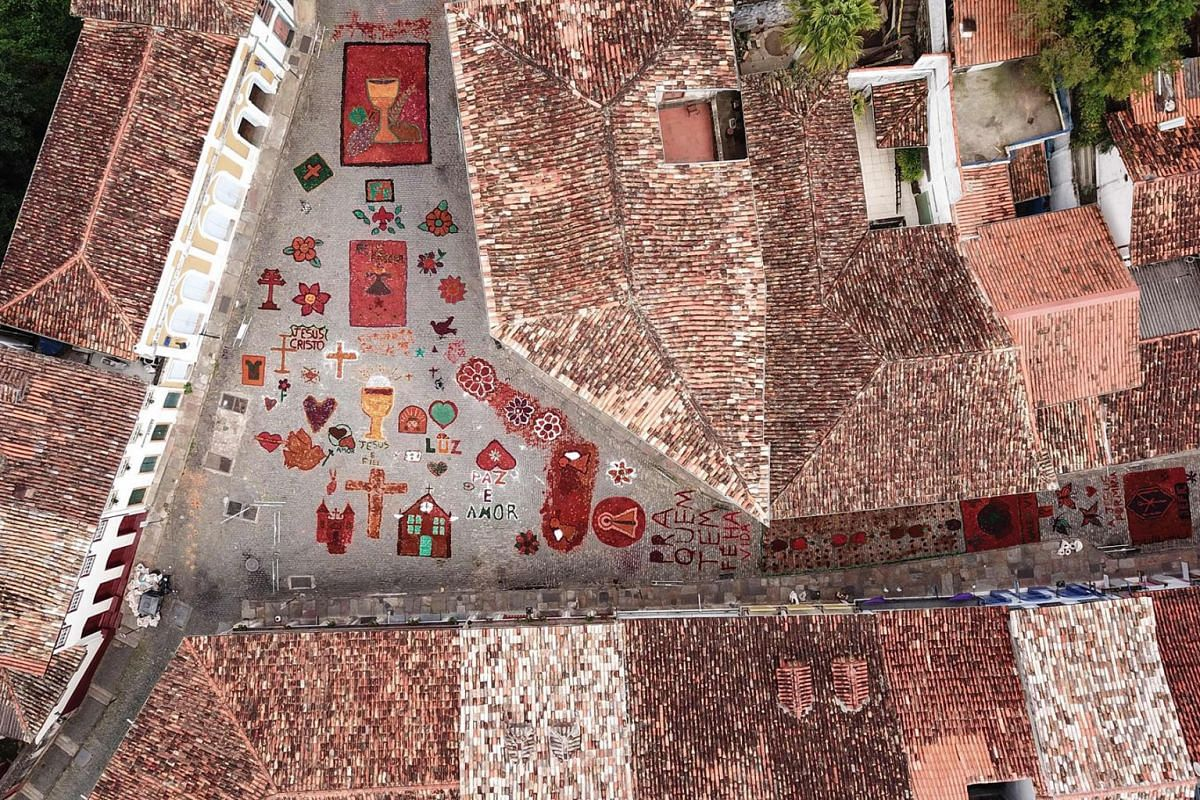Aerial picture showing sawdust rugs decorating a street in the Brazilian historic city of Ouro Preto, Minas Gerais State, on April 21, 2019 before an Easter procession representing the resurrection of Christ. PHOTO: AFP
