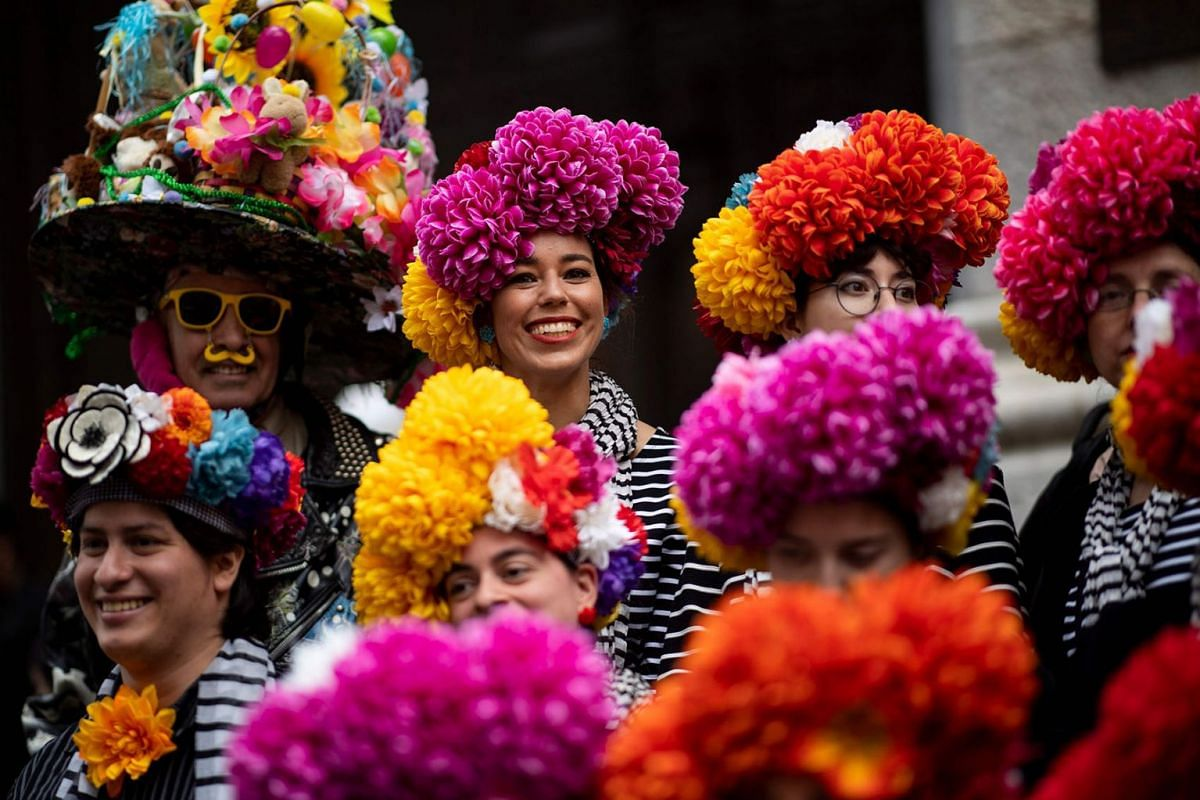 People wear decorated hats during the annual NYC Easter Parade and Bonnet Festival on 5th Avenue in Manhattan on April 21, 2019 in New York City. PHOTO: AFP