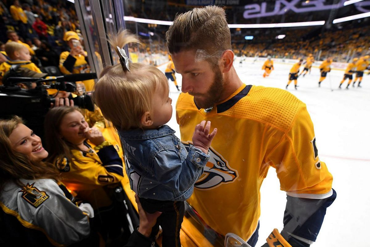 Nashville Predators left wing Austin Watson (51) makes faces at his daughter Olivia before the game against the Dallas Stars in game five of the first round of the 2019 Stanley Cup Playoffs at Bridgestone Arena on Apr 20, 2019 in Nashville, TN, USA.