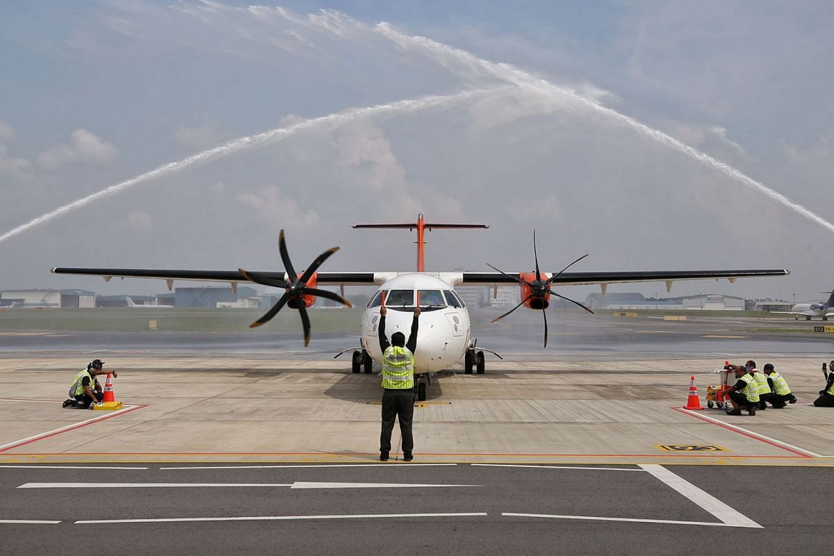 Malaysian carrier Firefly's aircraft receiving a water cannon salute at Singapore's Seletar Airport after completing its inaugural flight from Subang Airport on April 21, 2019. PHOTO: THE STRAITS TIMES/KEVIN LIM