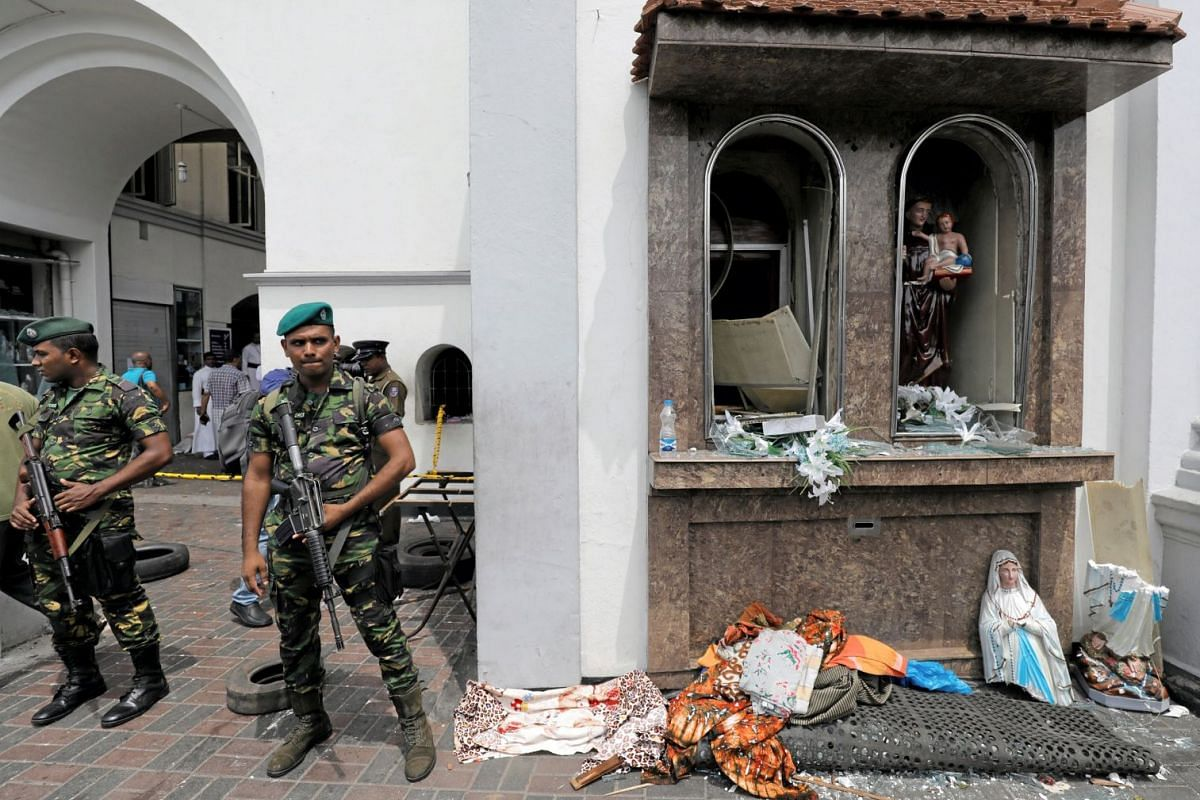 Sri Lankan military officials stand guard in front of St Anthony's Shrine, Kochchikade church after an explosion in Colombo, Sri Lanka, on April 21, 2019.