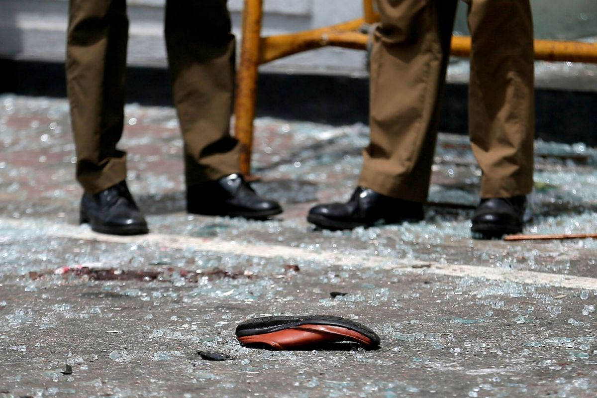 A victim's shoe is seen in front of St Anthony's Shrine, Kochchikade church after an explosion in Colombo, Sri Lanka, on April 21, 2019.