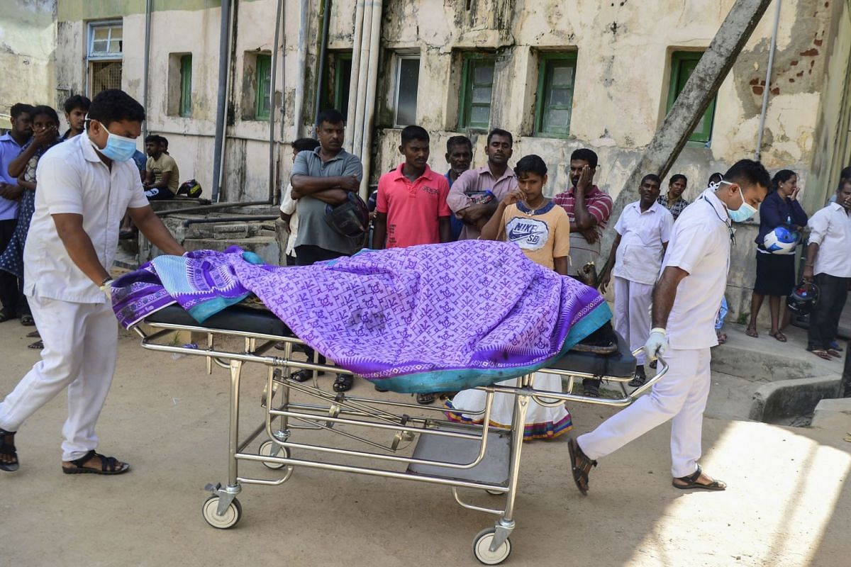 Sri Lankan hospital workers transport a body on a trolley at a hospital morgue following an explosion at a church in Batticaloa in eastern Sri Lanka, on April 21, 2019.