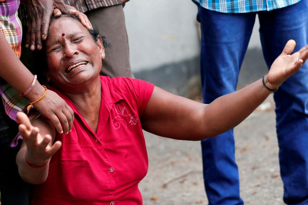 A relative of a victim of the explosion at St Anthony's Shrine, Kochchikade church, breaks down at the police mortuary in Colombo, Sri Lanka, on April 21, 2019.