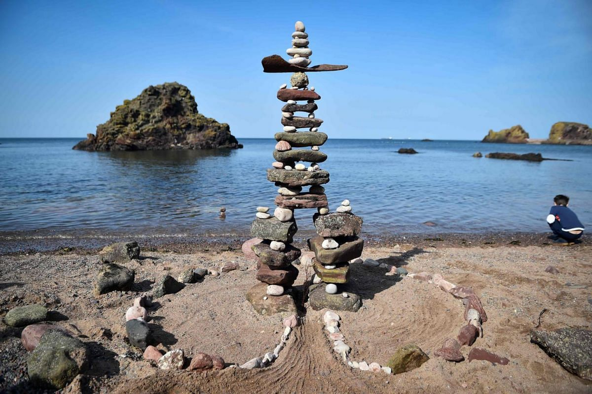 A balanced sculpture built near the sea at the European Stone Stacking Championships 2019.