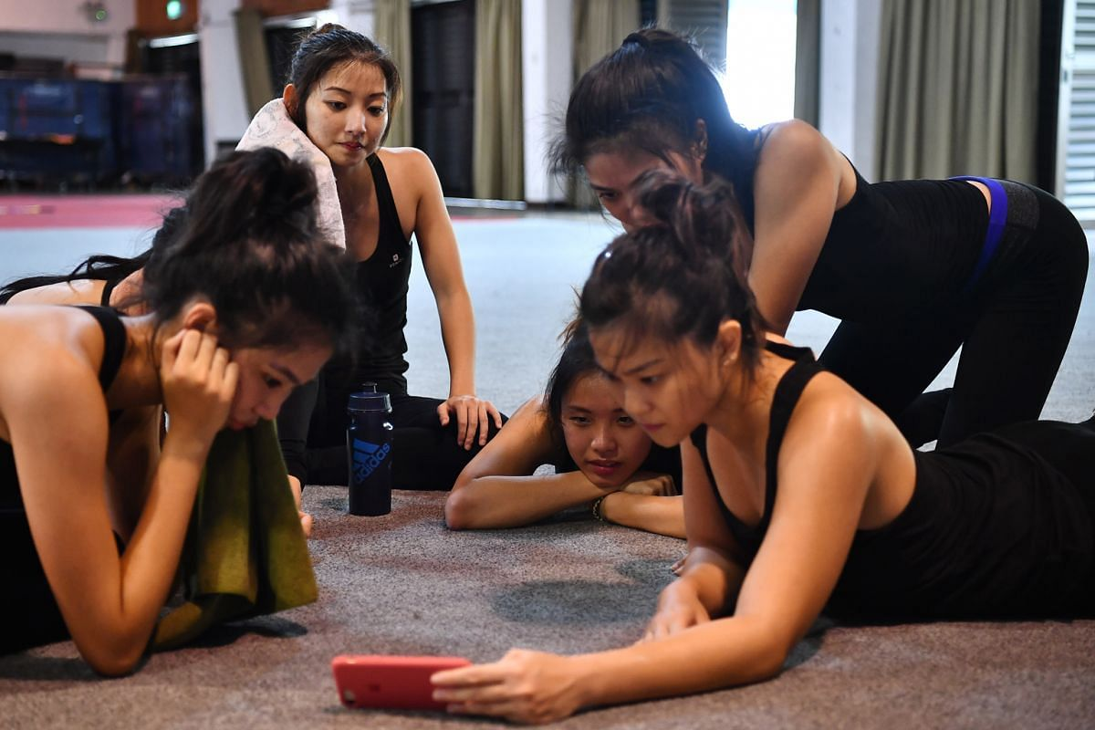 Team members analysing their routine in order to spot mistakes and work on improvements during a training session at Shelton College International on Feb 16.