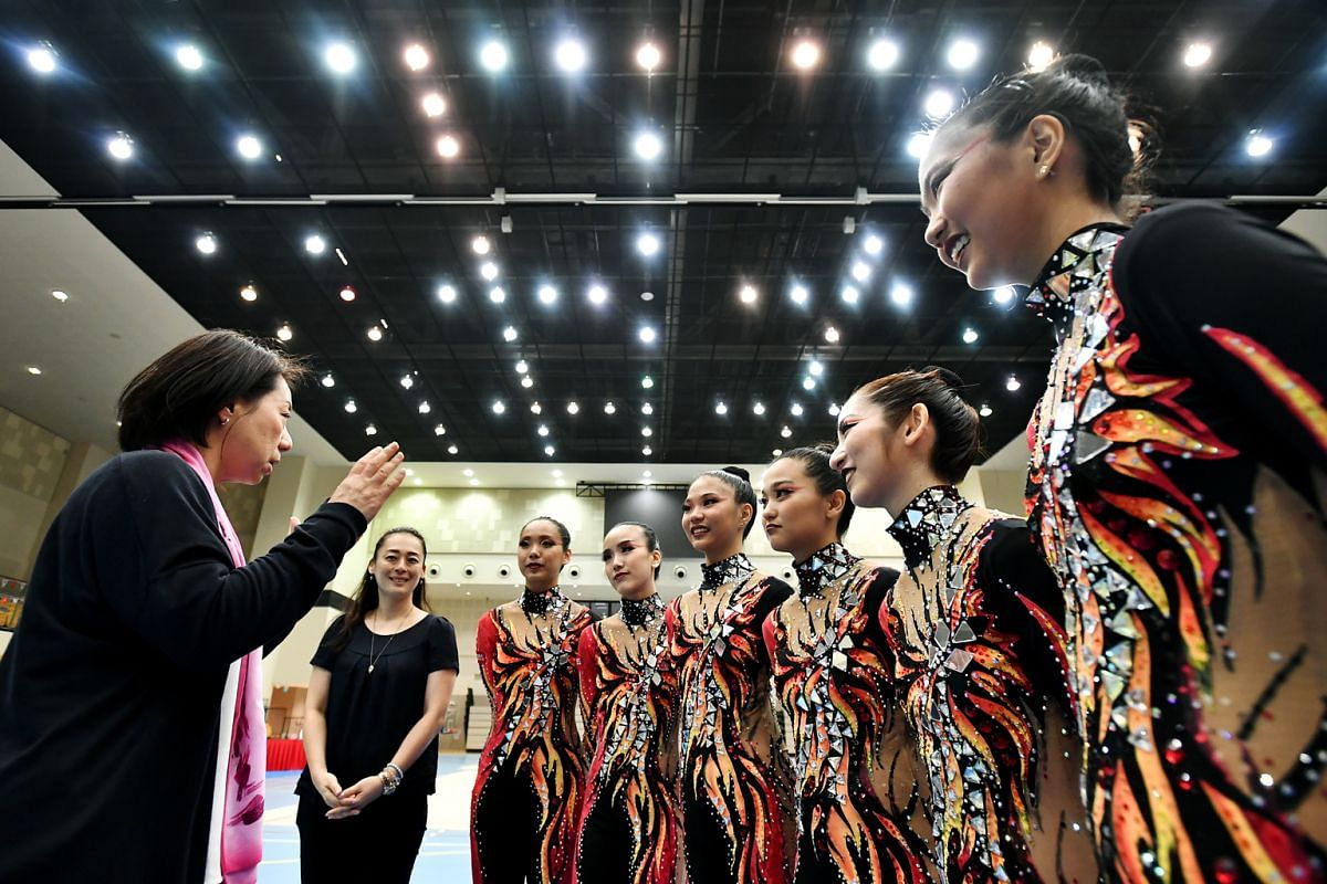 Coach Saori Kubota (left) giving advice and encouragement to the Singapore team ahead of the aesthetic group gymnastics World Championships in Spain. She was