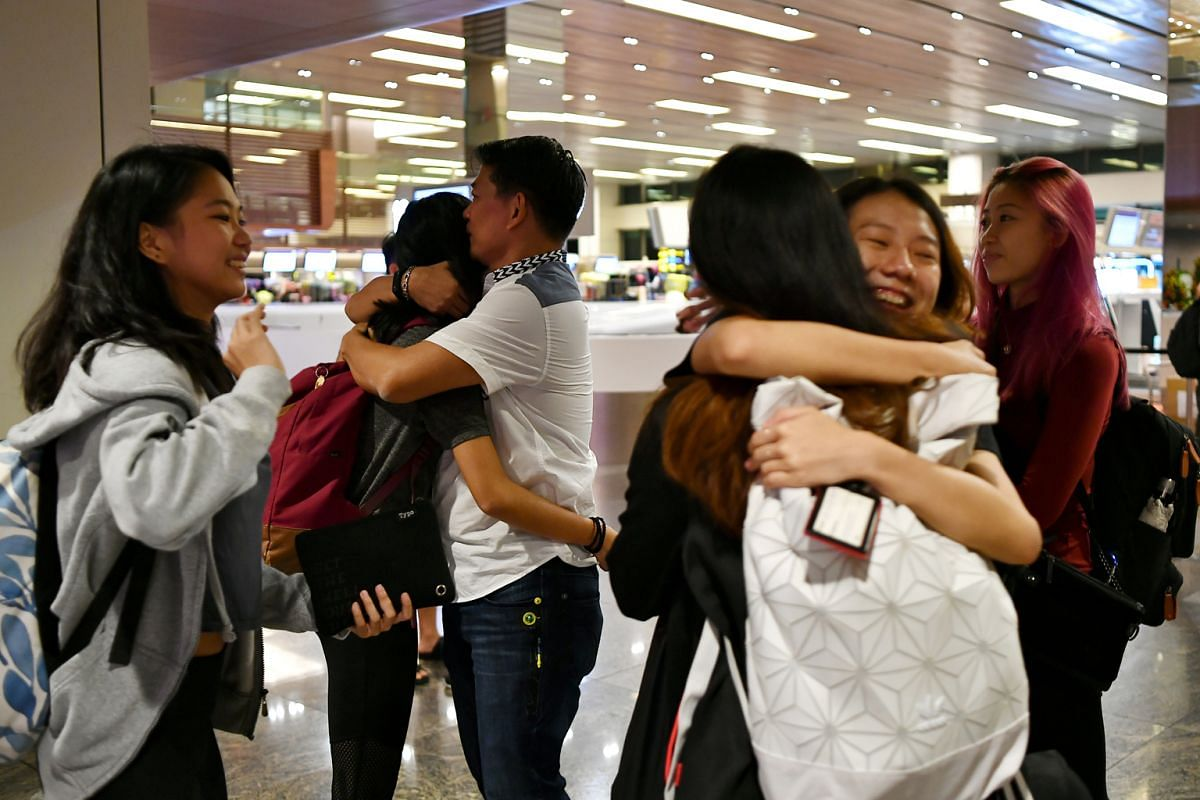 Team members saying their farewells at Changi Airport on Jan 31 before they left for a boot camp in Japan.