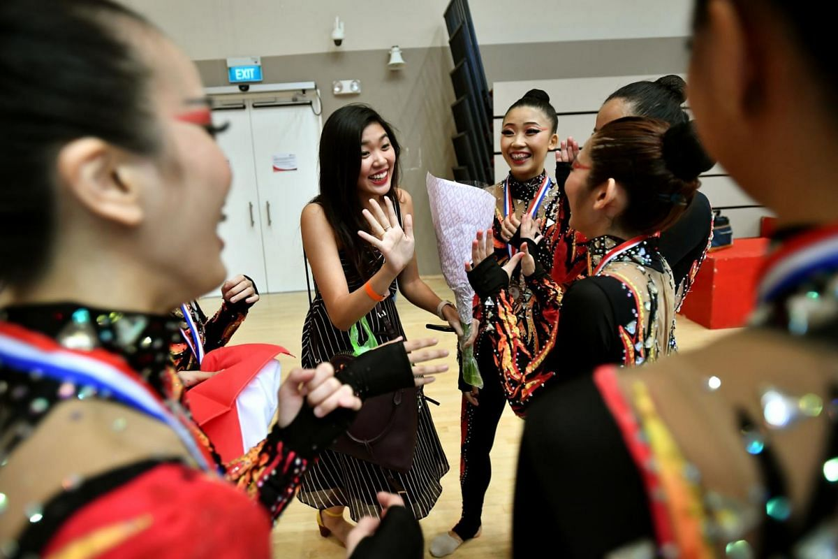 Ms Phaan Yilin, 24, congratulating the Singapore team after their performance at the preliminaries of the Aesthetic Group Gymnastics World Cup ll event. She used to be part of the team but she could not continue due to work commitments.