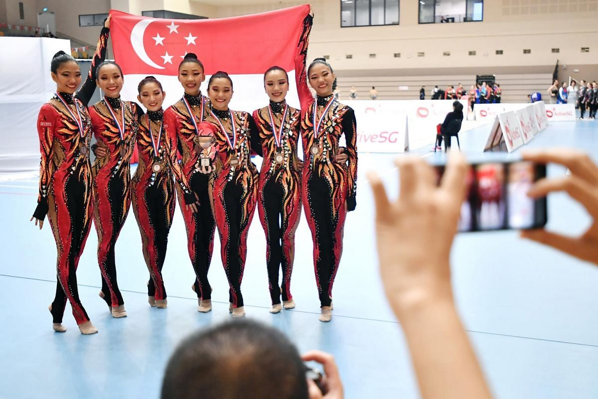 The Singapore team taking a group photograph after their performance at the preliminaries of the Aesthetic Group Gymnastics World Cup ll event.