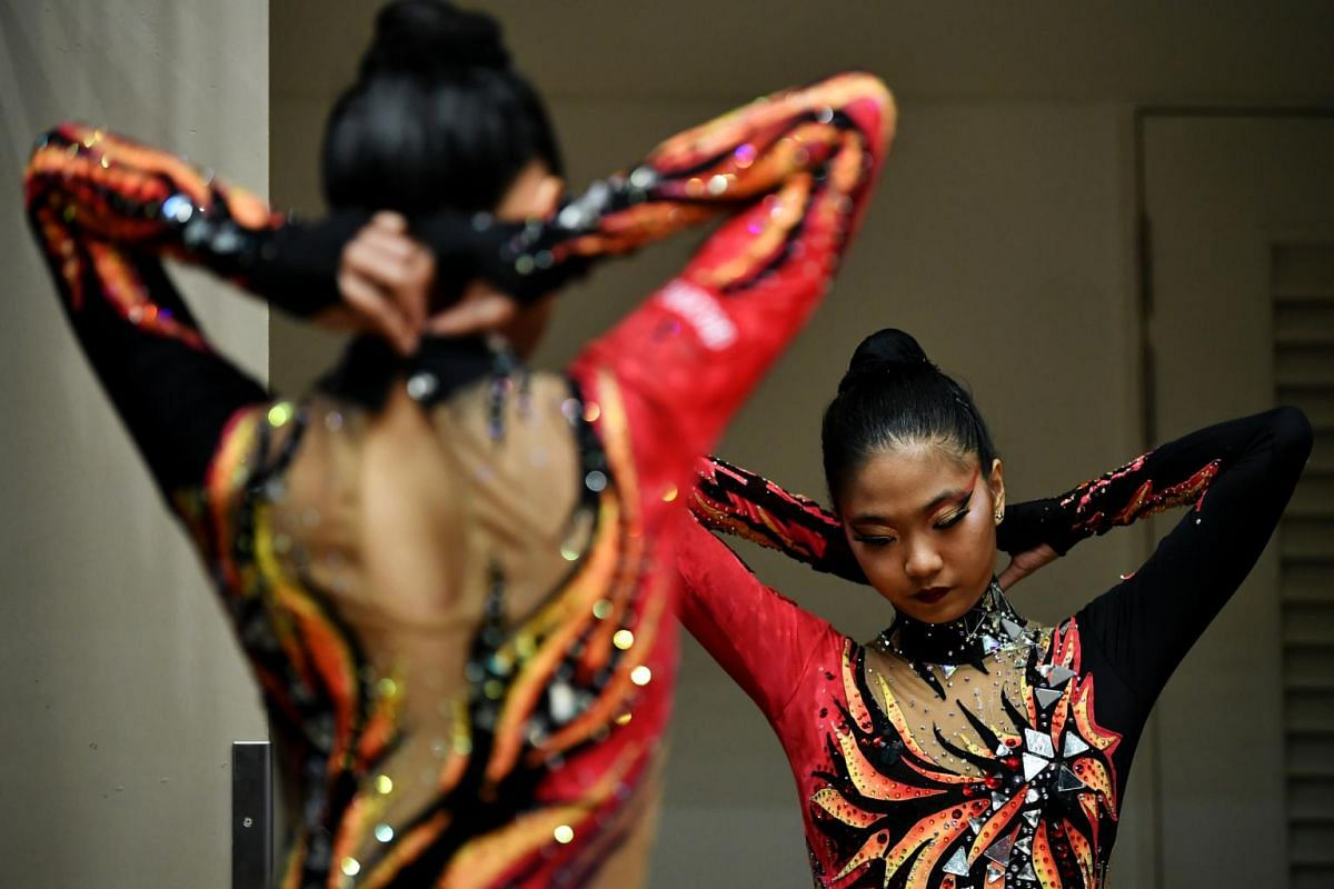 Ms Phebe Lau (right) and Ms Michele Lau wearing their leotards before the Aesthetic Group Gymnastics World Cup ll event at Our Tampines Hub, on April 4, 2019.