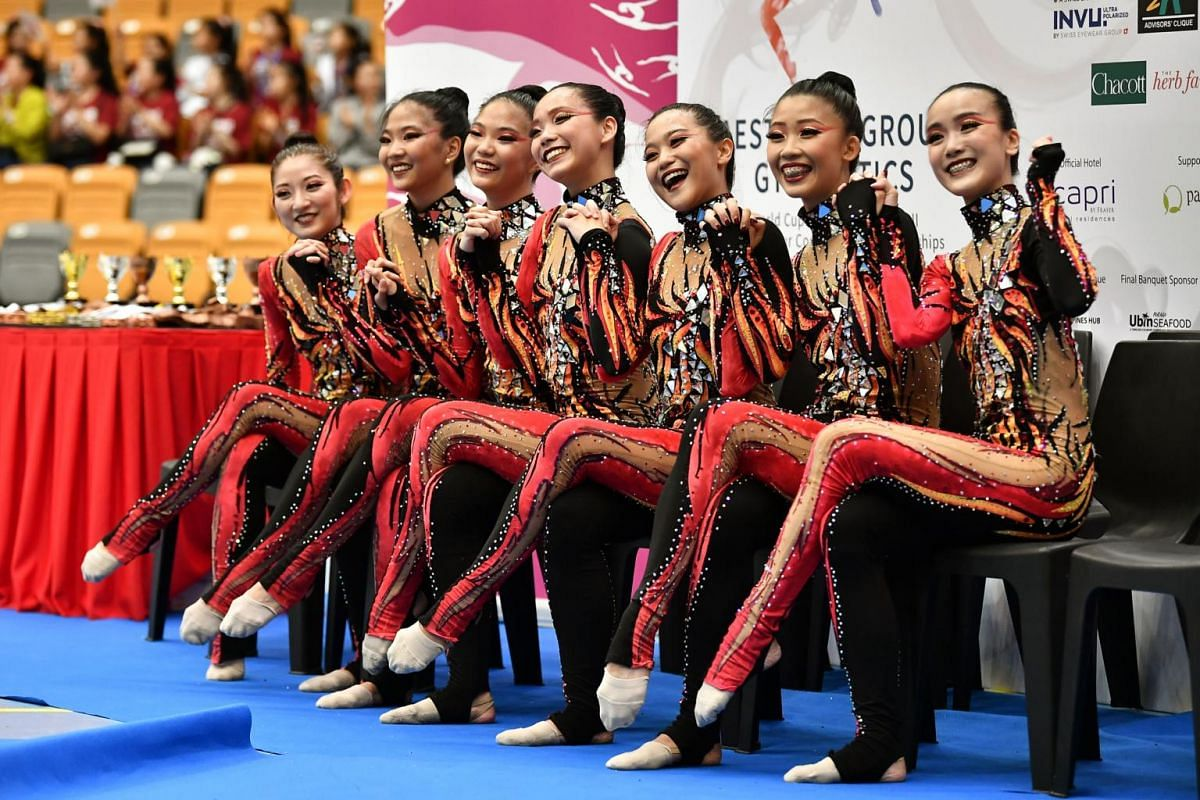 The Singapore team taking a group photo at the kiss and cry corner after their performance in the Aesthetic Group Gymnastics World Cup ll event at Our Tampines Hub. They came in 10th out of 16 teams in the Women's category.