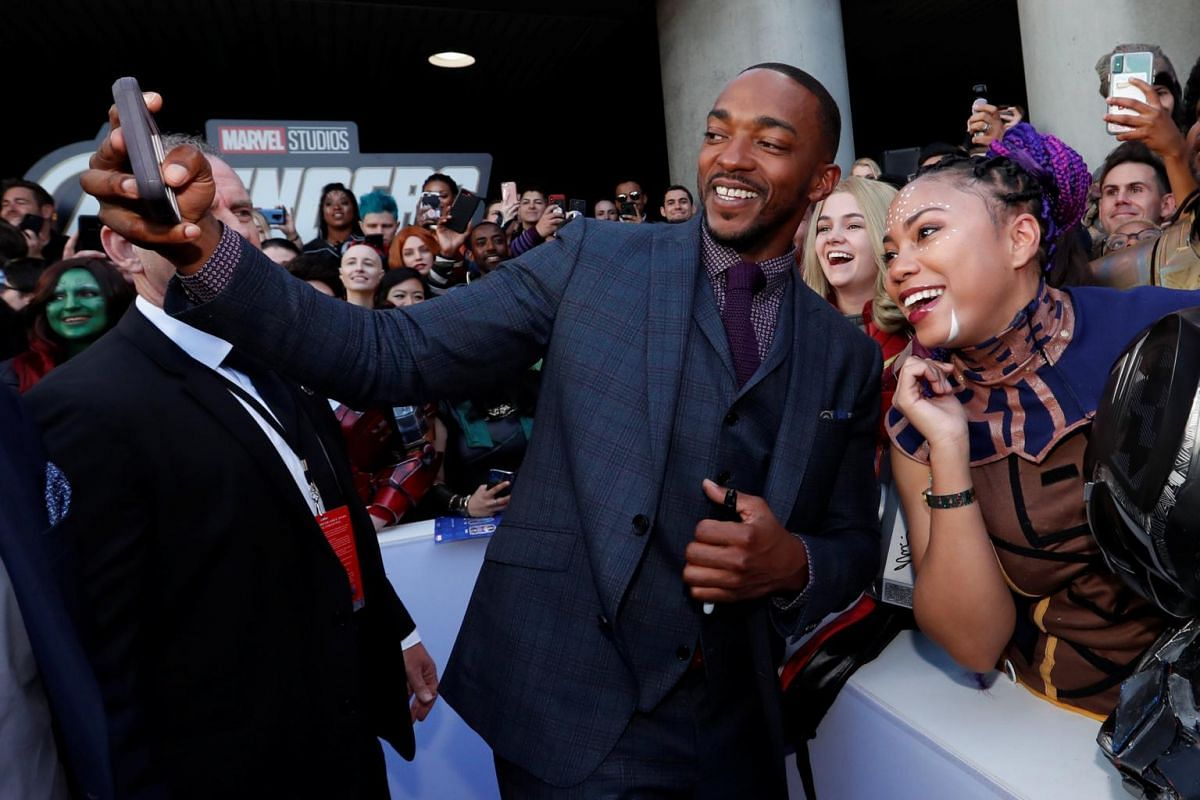 Actor Anthony Mackie, who plays Falcon in the Avengers, poses with fans on the red carpet of the Avengers: Endgame world premiere.