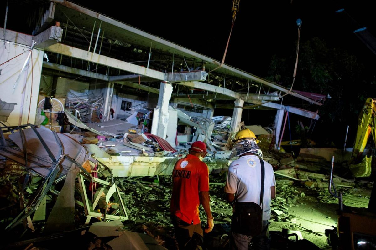 Eight people were killed when two buildings and some houses collapsed in two towns in Pampanga province.