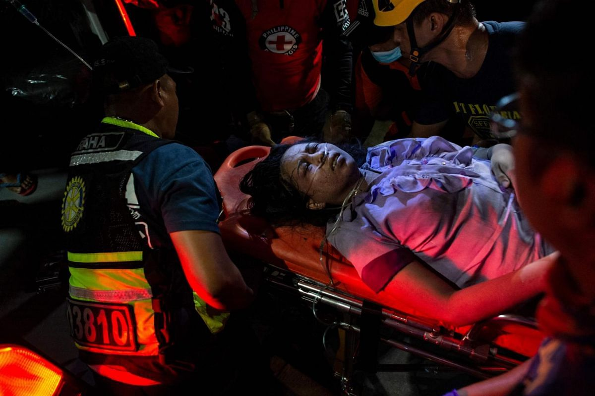 A badly injured victim in Porac, Pampanga. The 6.3-magnitude earthquake struck 60km north-west of Manila at a depth of 40km.