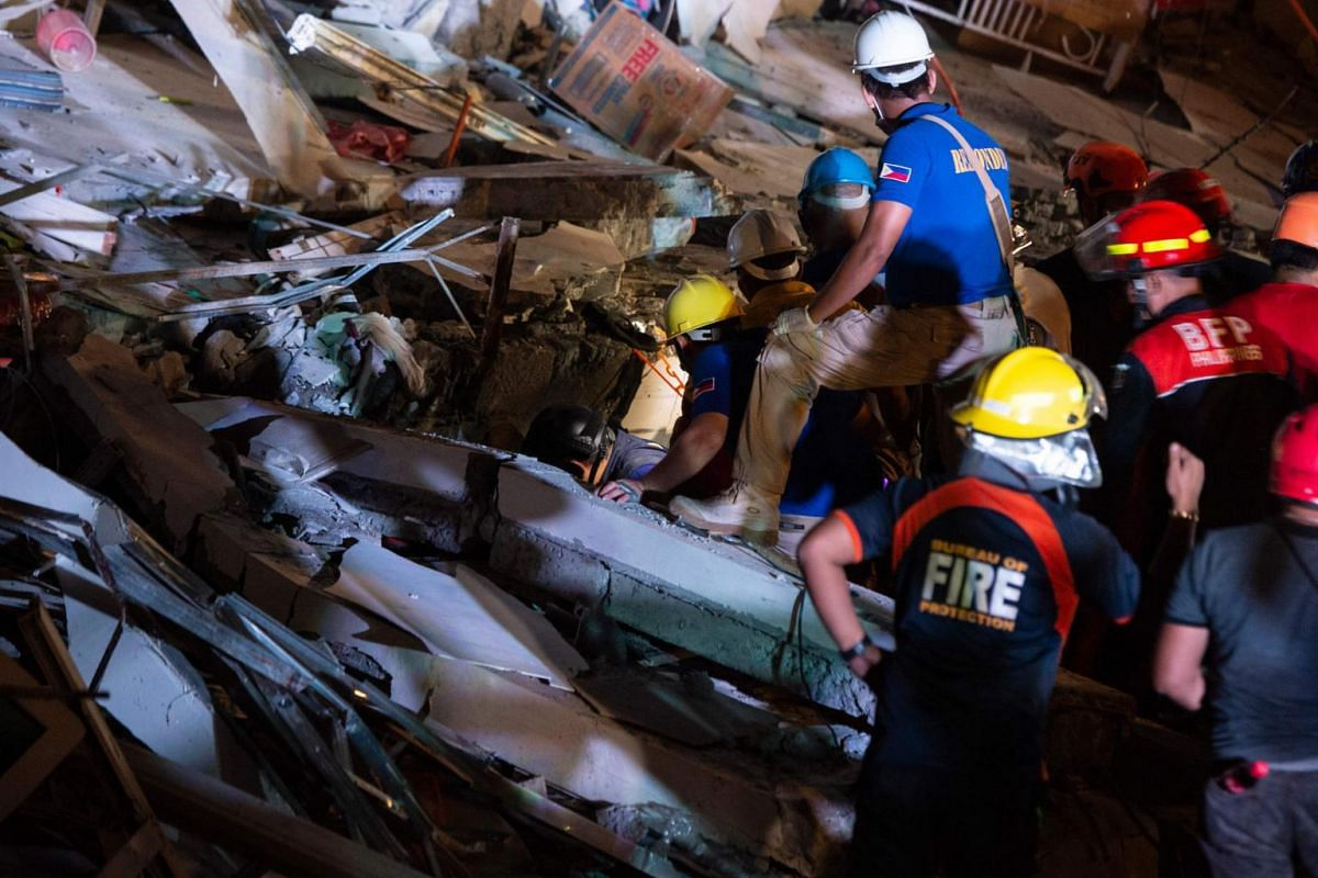 Rescue workers in Porac search for survivors.