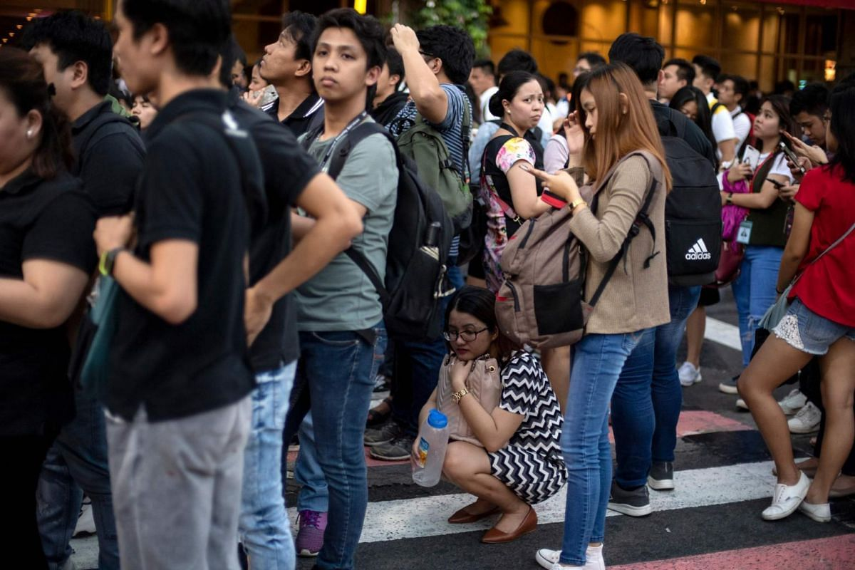 People flee offices, residential buildings and shopping malls across Metro Manila after the earthquake hit.