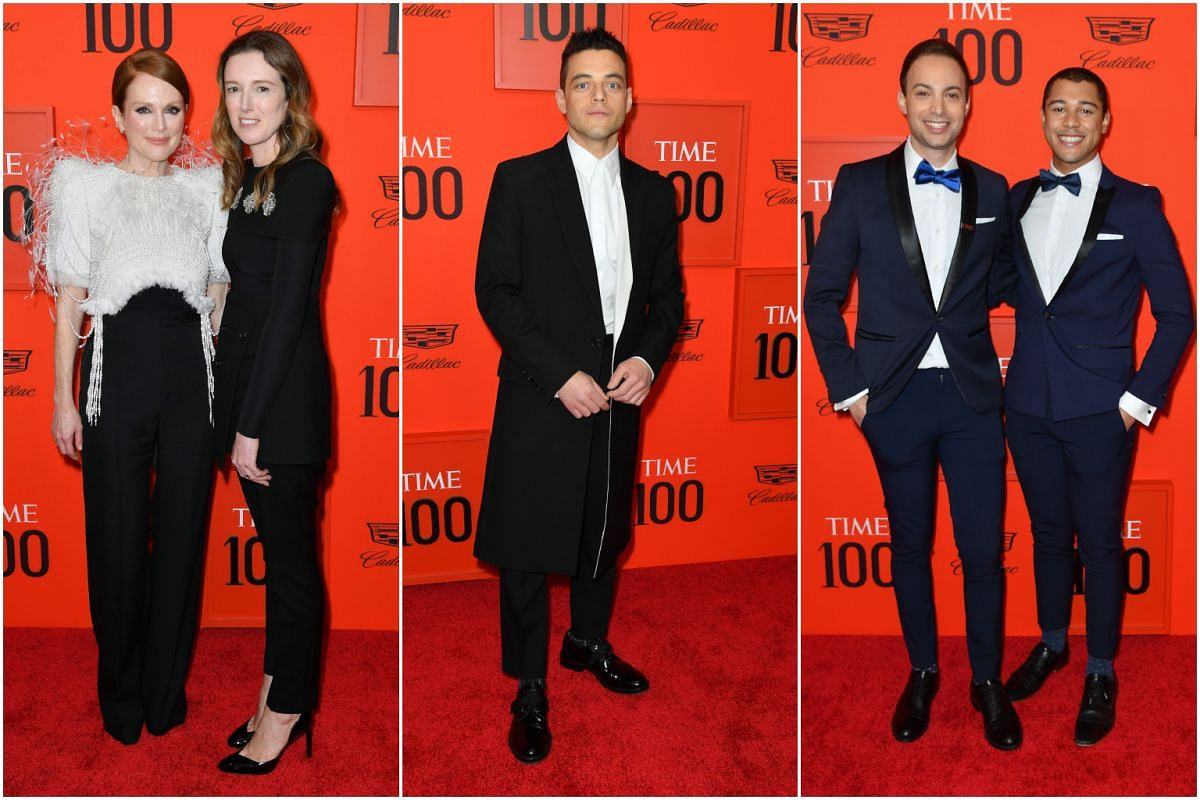 (From left) Actress Julianne Moore and stylist Clare Waight Keller, actor Rami Malek, editorial director of special projects for Time Magazine Dan Macsai and his husband Ronnie Hutchinson.