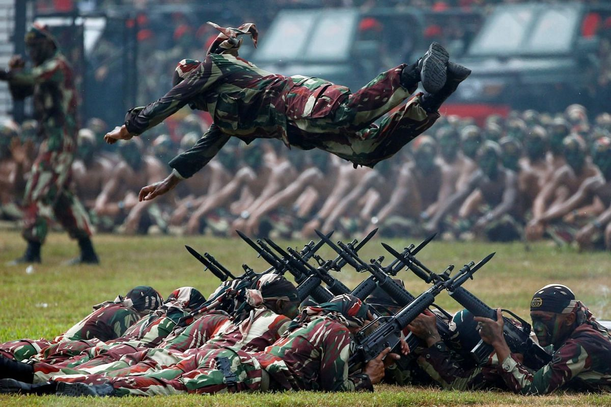 Indonesian army special forces soldier performs a jump during celebrations for the 67th anniversary of the Indonesia Army Special Forces in Jakarta, Indonesia, April 24, 2019. PHOTO: REUTERS