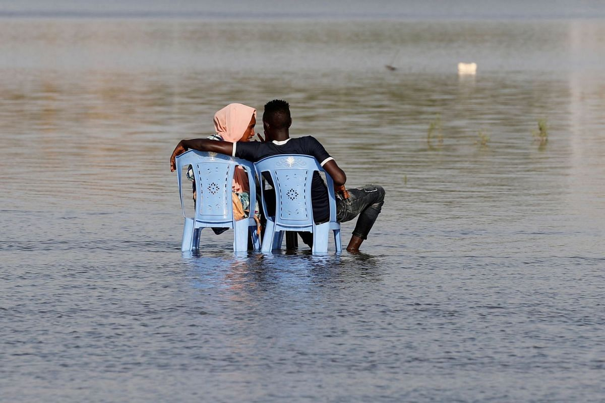 A Sudanese couple enjoy the shallow waters of the Nile River in Khartoum, Sudan, April 24, 2019. PHOTO: REUTERS