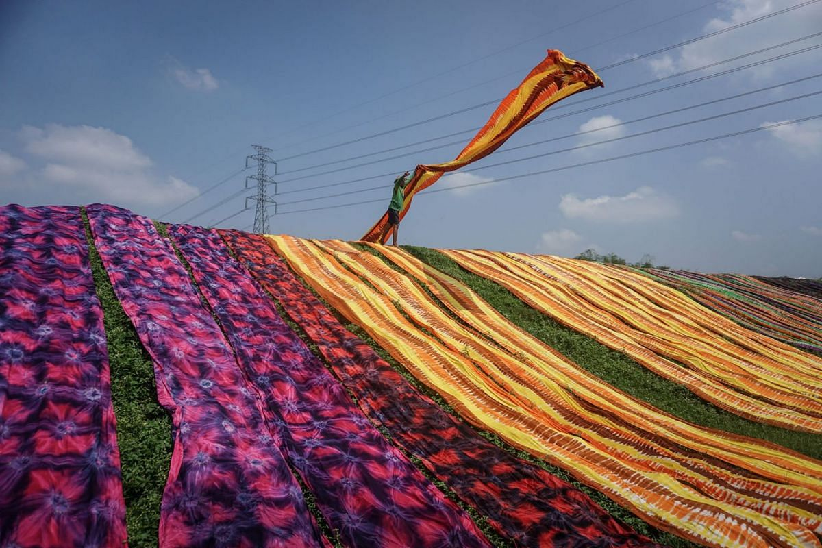 A worker throws a cloth during a drying process at Sukoharjo near Solo, Central Java province, Indonesia, April 23, 2019 in this photo taken by Antara Foto. PHOTO: ANTARA FOTO VIA REUTERS