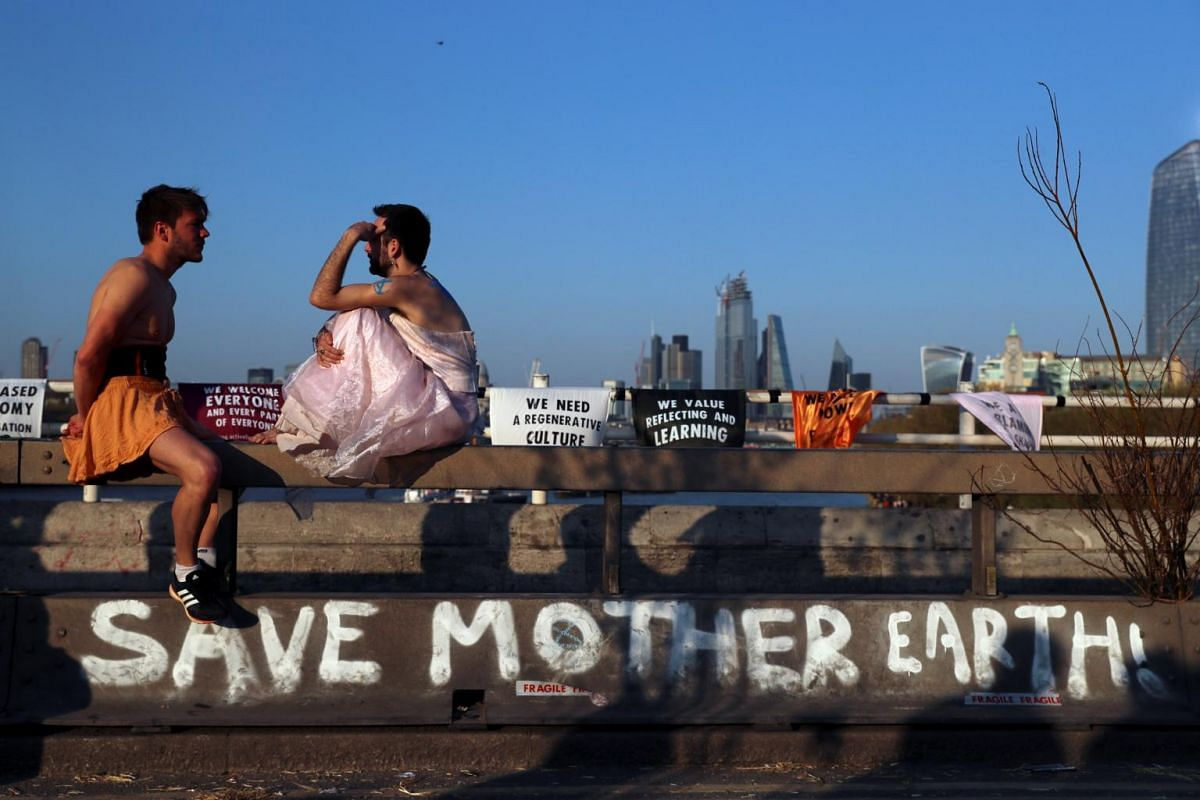 Protesters talk during the Extinction Rebellion protest on Waterloo Bridge in London, on April 20, 2019.