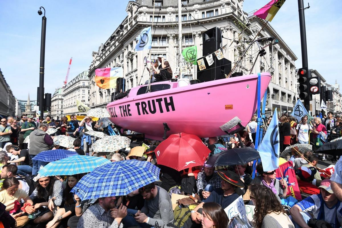 Protesters block the road during Extinction Rebellion climate change protests on Oxford Circus in London, on April 18, 2019.