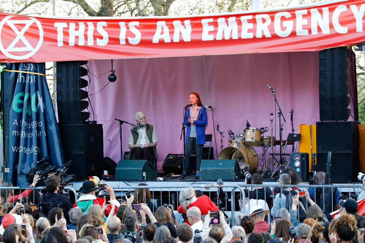 Swedish climate change activist Greta Thunberg speaks at the Extinction Rebellion group's protest camp at Marble Arch in London, on April 21, 2019, on the seventh day of the protest calling for political change to combat climate change.