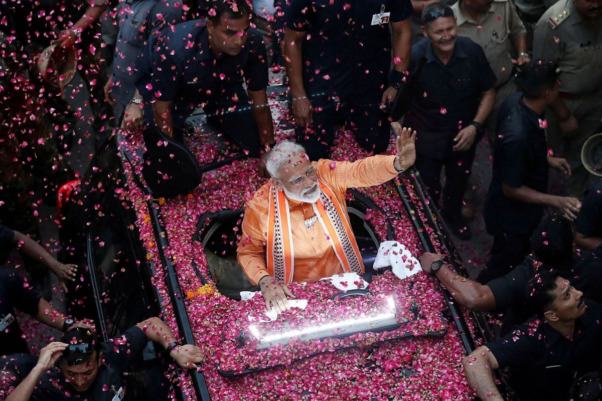 India's Prime Minister Narendra Modi waves towards his supporters during a roadshow in Varanasi, India, April 25, 2019. PHOTO: REUTERS