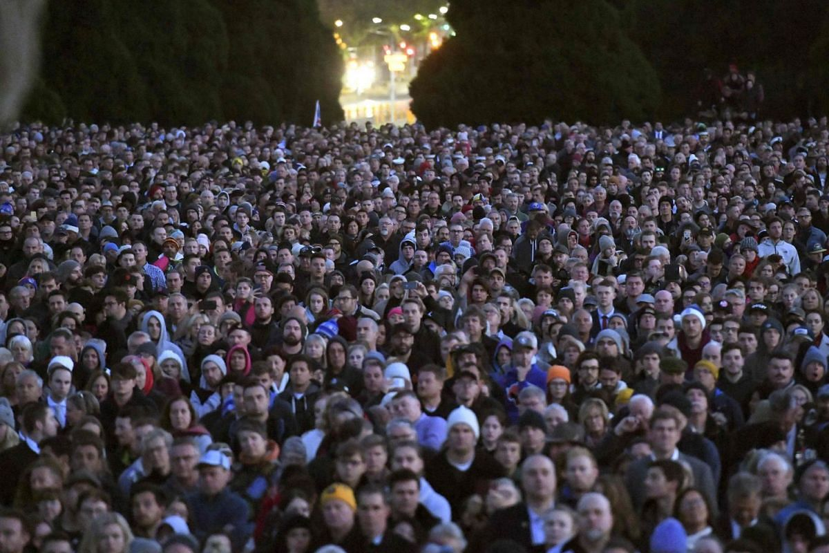 People gathering at the Shrine of Remembrance for an Anzac Day dawn service in Melbourne.