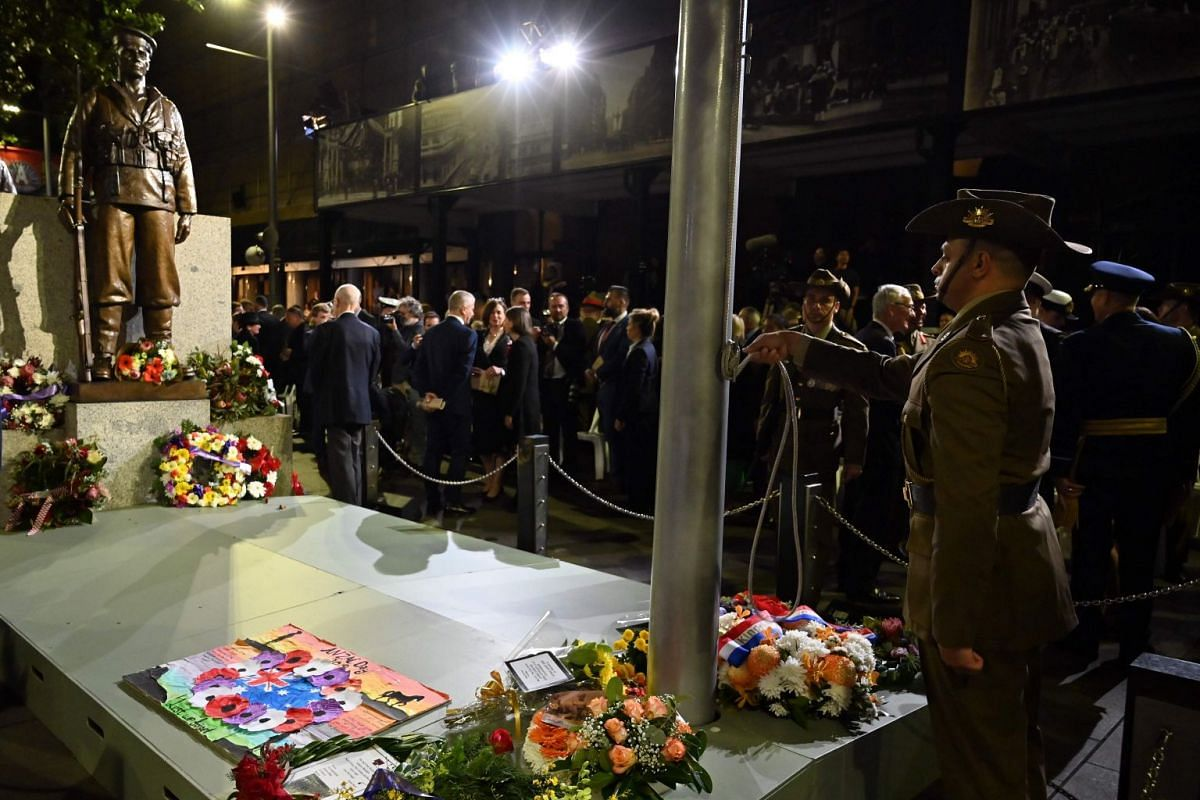War veterans and other guests attend an Anzac Day dawn service in Sydney.