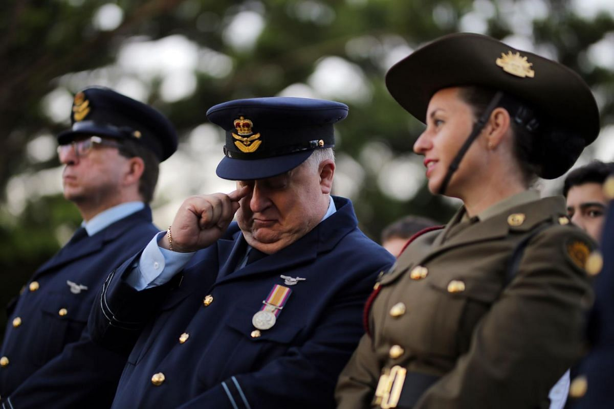 Gary Hayward (centre) of the 324 Squadron reacts during an Anzac Day dawn service at Coogee Beach in Sydney.