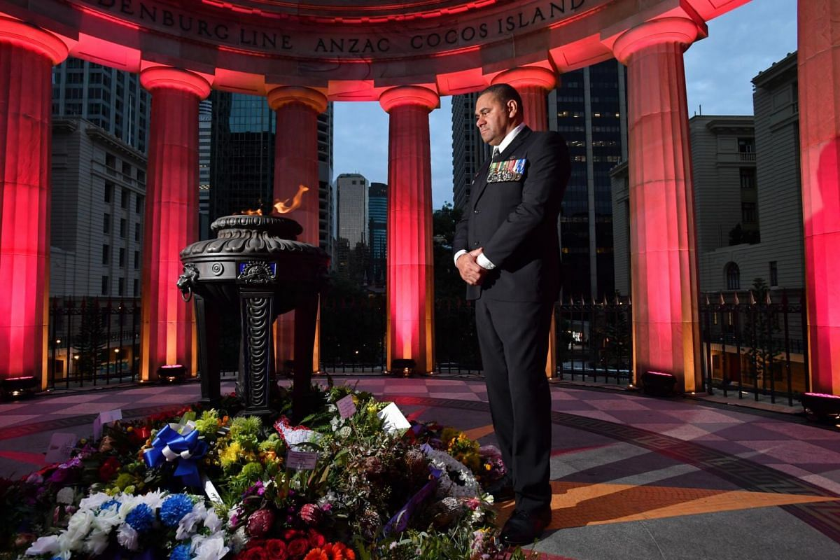Australian Army veteran Peter Rabula posing for a photograph after an Anzac Day dawn service at the Shrine of Remembrance in Brisbane.