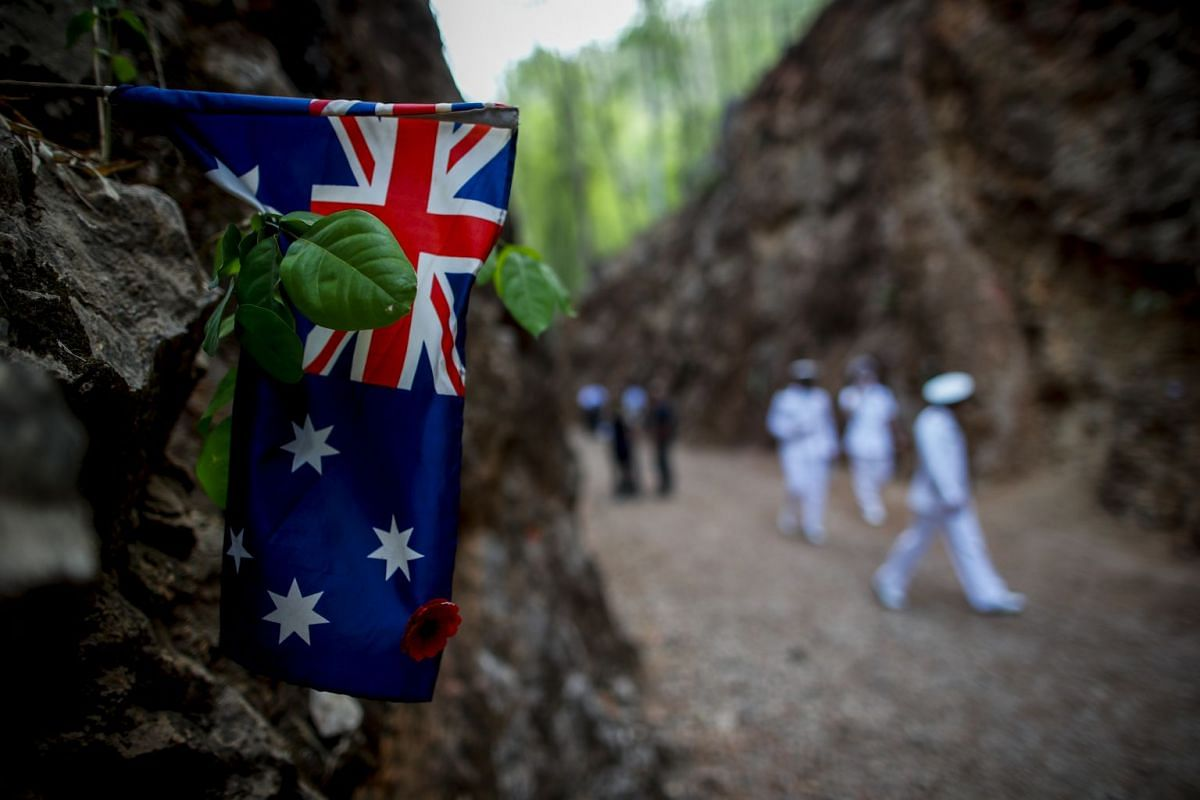 An Australian flag laid in memory of those who died at the Hellfire Pass section of the Thai-Burma railway, following the Anzac Day war memorial service in Kanchanaburi, Thailand.