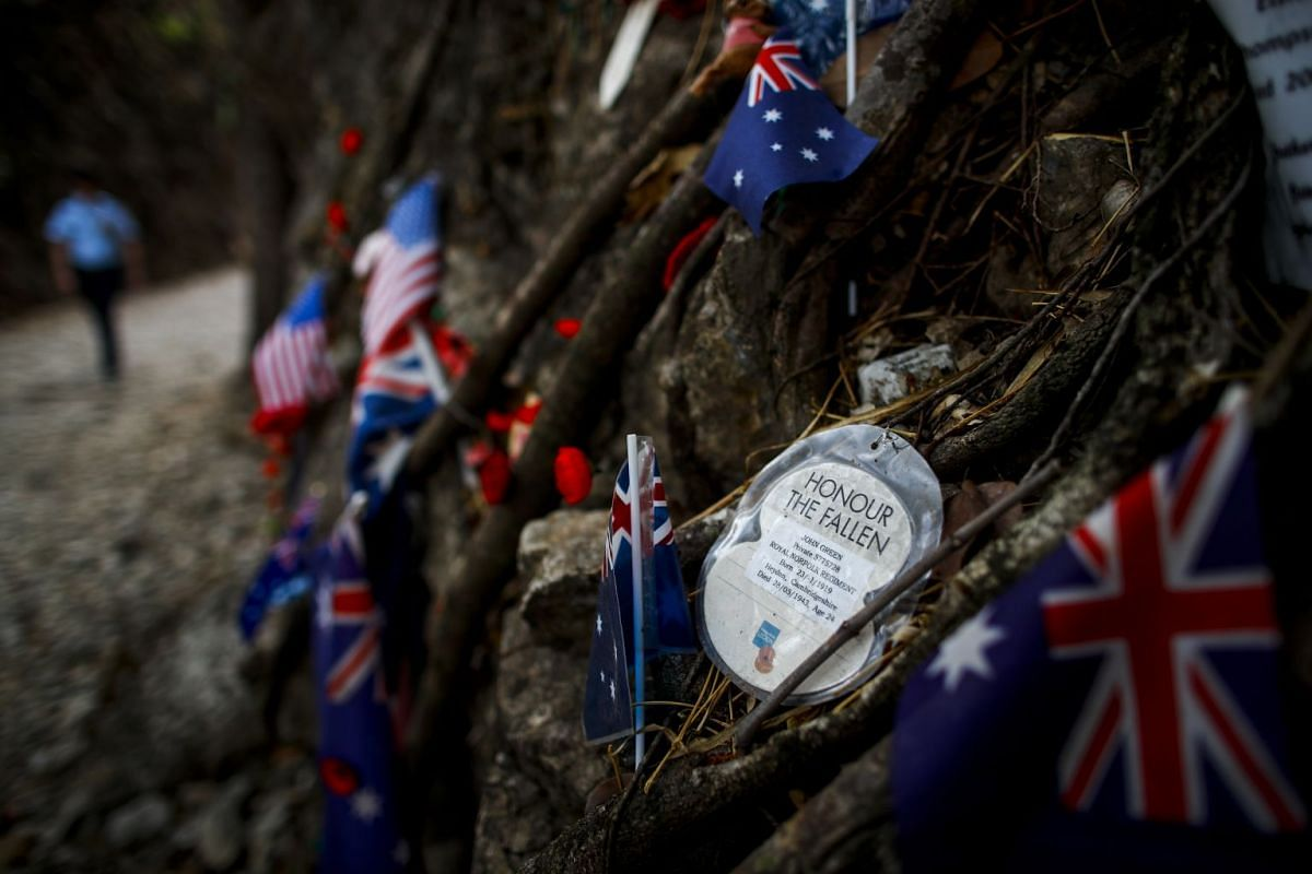An Australian flag laid in memory of those who died at the Hellfire Pass section of the Thai-Burma railway, following an Anzac Day war memorial service in Kanchanaburi, Thailand.