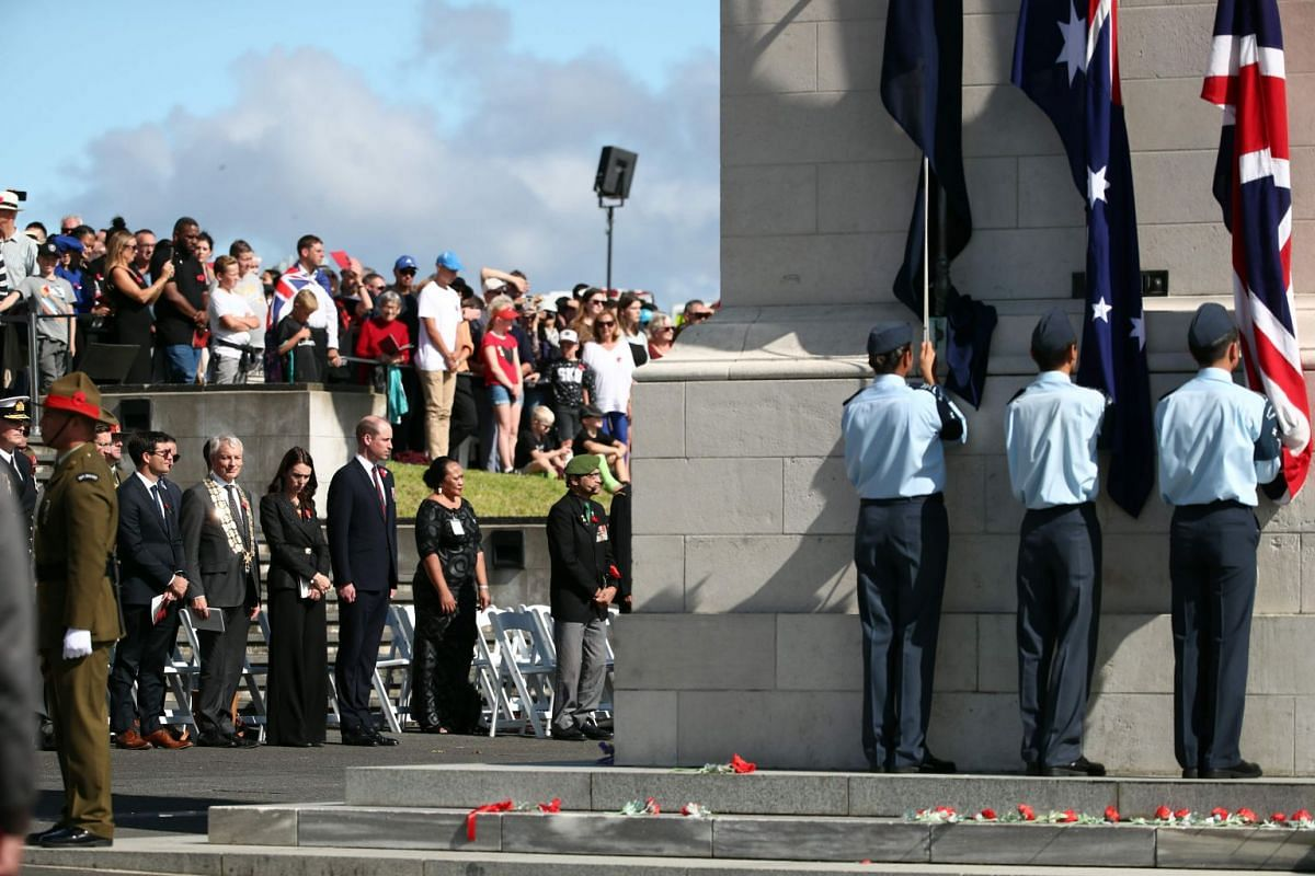Britain's Prince William (front row, third from right) and New Zealand Prime Minister Jacinda Ardern (front row, fouth from right) attending the Anzac Day service at the Auckland War Memorial Museum.